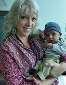 Jeanne Kettles, Regional Breastfeeding Liaison holding infant