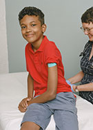 Young Boy Smilling with Bandaid on his arm